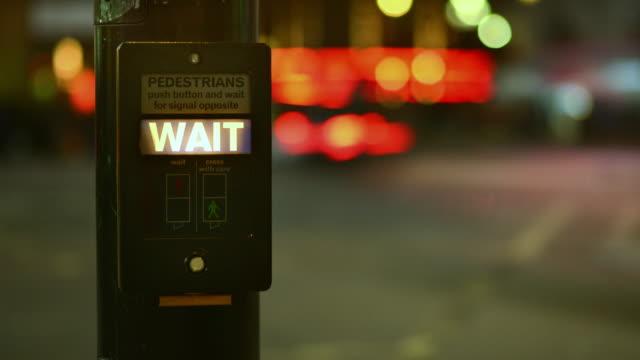 stockvideo's en b-roll-footage met cu t/l shot of traffic defocus night pedestrian crossing push button and wait light sharp / london, greater london, united kingdom - greater london