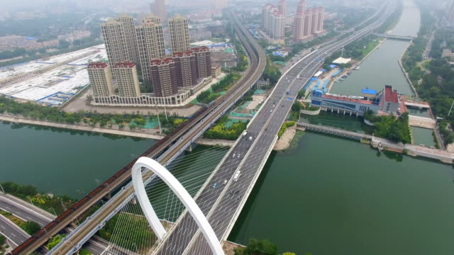 aerial shot of traffic moving on bridge and overpasses ,tianjin,china. - motorway stock videos & royalty-free footage