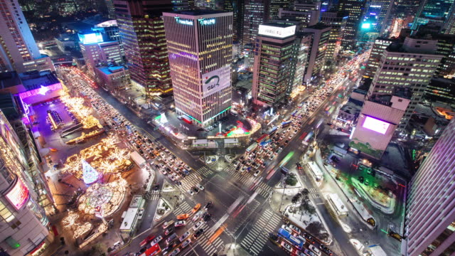 MS T/L Shot of traffic moving on crossroad through euljiro 1(il) ga Station at night / Seoul, South Korea