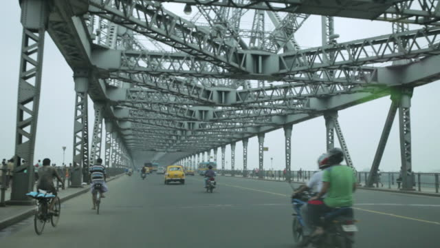 ms pov shot of traffic moving on howrah bridge / kolkata, west bengal, india - howrah bridge stock videos and b-roll footage