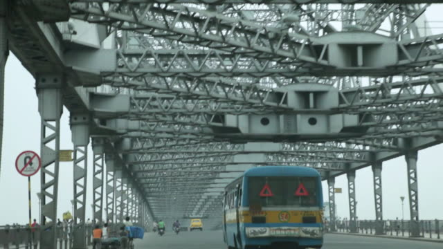 MS POV Shot of traffic moving on Howrah Bridge / Kolkata, West Bengal, India