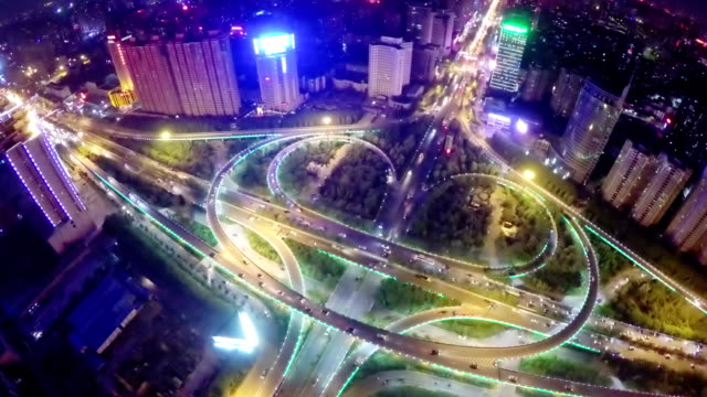 ws aerial shot of traffic moving on overpasses at night /xi'an,china. - elevated road stock videos & royalty-free footage