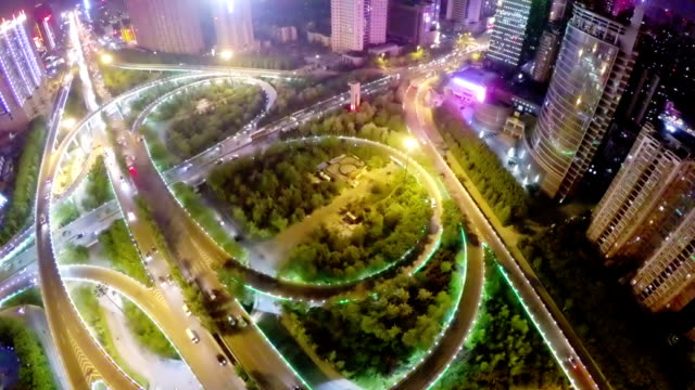 T/L WS AERIAL Shot of traffic moving on overpasses at night /Xi'an,China.