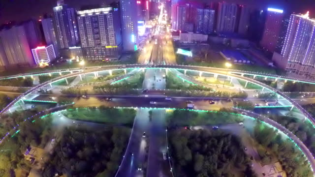 WS AERIAL Shot of traffic moving on overpasses at night /Xi'an,China.