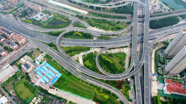 T/L AERIAL shot of traffic moving on overpasses ,Tianjin,China.