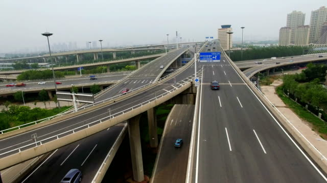 aerial shot of traffic moving on overpasses ,tianjin,china. - tianjin stock videos & royalty-free footage