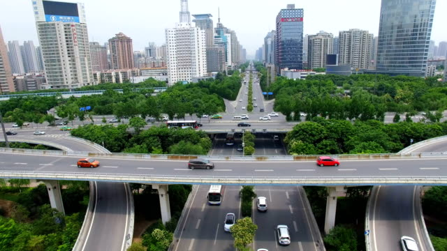 AERIAL Shot of traffic moving on overpasses/Xi'an,China.