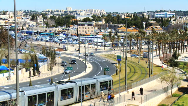 ws td shot of traffic moving on road and lightrail train near old city walls / jerusalem, judea, israel - jerusalem stock videos & royalty-free footage
