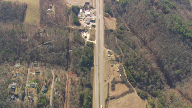 MS AERIAL Shot of traffic moving on road surrounded by trees in Nantahala National Forest / North Carolina, United States