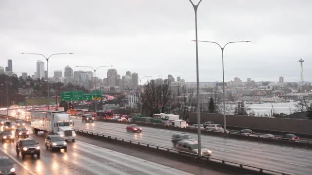 WS Shot of traffic moving on street at foggy rainy day during winter / Seattle, Washington, United States