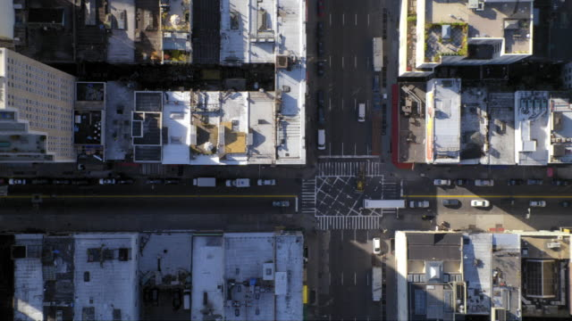 MS AERIAL Shot of traffic moving on street intersection in Manhattan / New York, United States