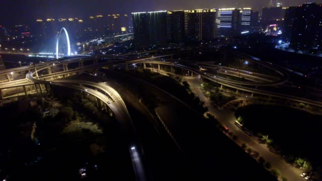 AERIAL shot of traffic on overpass at night/Tianjin,China