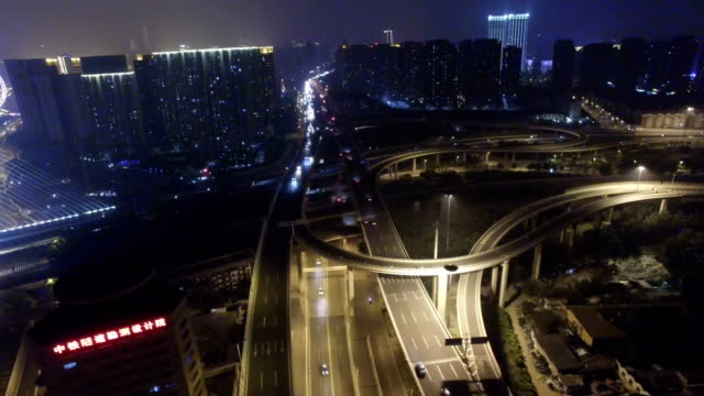 T/L AERIAL shot of traffic on overpass at night/Tianjin,China