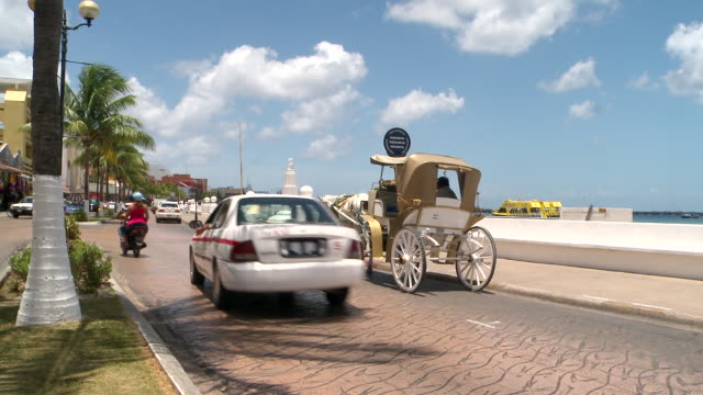 ms shot of traffic on the promenade by the sea / cozumel, quintana roo, mexico - quintana roo stock videos and b-roll footage