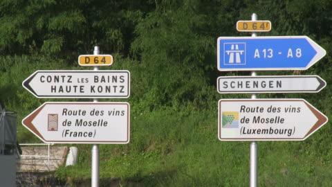 ms shot of traffic signs / contz-les-bains, lorraine, france - lorraine stock-videos und b-roll-filmmaterial