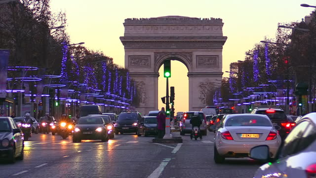 MS Shot of Traffic with Avenue des Champs Elysees and Arc de Triomphe / Paris, Ile de France, France