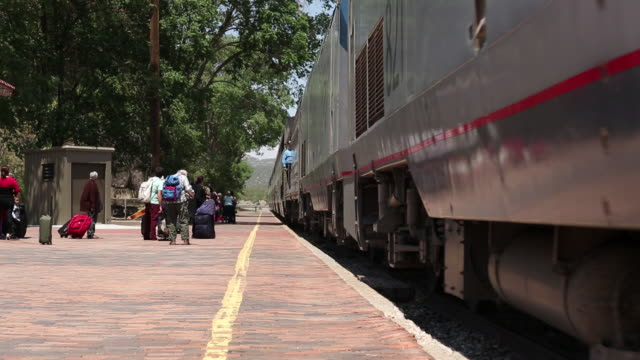 ms pan shot of train arriving at station / lamy, new mexico, united states - lamy new mexico stock videos and b-roll footage