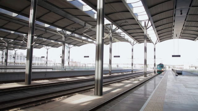 ms shot of train coming to platform of railway station / tianjin, china - railway station platform stock videos & royalty-free footage