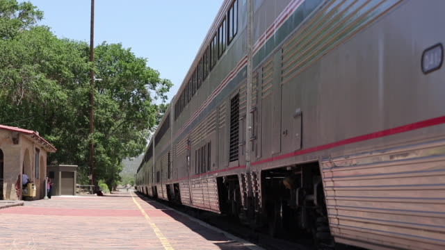 ms pan shot of train leaving station / lamy, new mexico, united states - lamy new mexico stock videos and b-roll footage