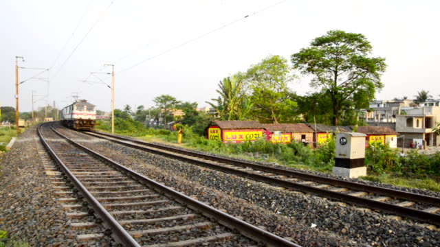 ms shot of train moving on railroad track / kolkata, west bengal, india - west bengal stock videos and b-roll footage