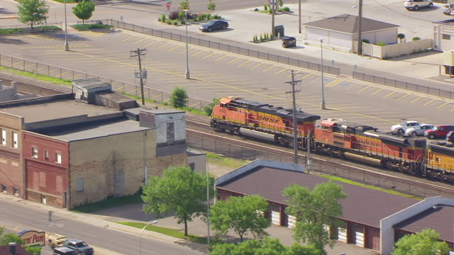ms aerial ts shot of train on track as part of train and northern pacific railway depot / fargo, north dakota, united states - north pacific stock videos & royalty-free footage
