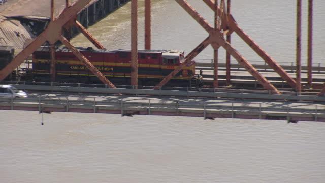 cu aerial zo shot of train over bridge with exxon mobil / louisiana, united states - exxon stock videos & royalty-free footage