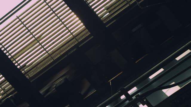 MS LA Shot of Train Passes Overhead Rails / New York, United States