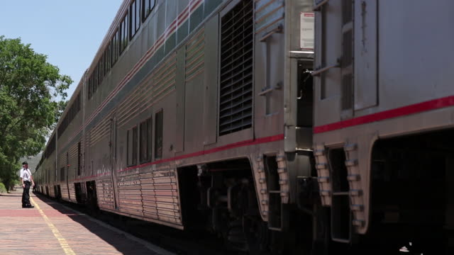 ms pan shot of train stopped at station / lamy, new mexico, united states - lamy new mexico stock videos and b-roll footage
