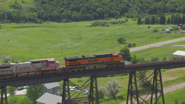 MS AERIAL TS ZO Shot of Train traveling over Gasman Coulee Railroad Trestle / Minot, North Dakota, United States