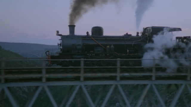 ms ts shot of train travelling on tracks - steam train stock videos & royalty-free footage