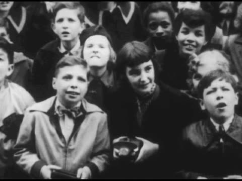 / shot of train with people gathered / high angle of crowd below train / shots of children wandering about the train / conductor giving a lesson /... - 1951 stock videos & royalty-free footage