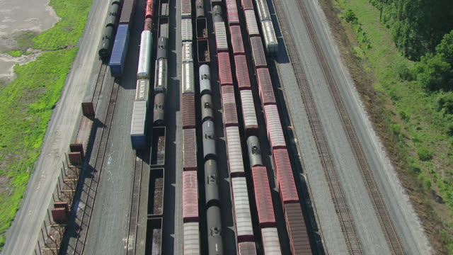 ms aerial tu shot of trains at rail yard in day light / jackson, mississippi, united states - 操車場点の映像素材/bロール