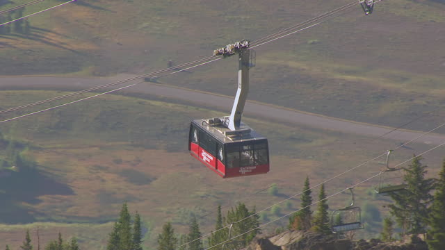 ms aerial ts shot of tram riding up mountain using tension cables / jackson wyoming united states - wyoming stock videos & royalty-free footage