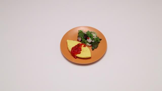 MS Shot of transferring Omelet on Crockery / Seoul, South Korea
