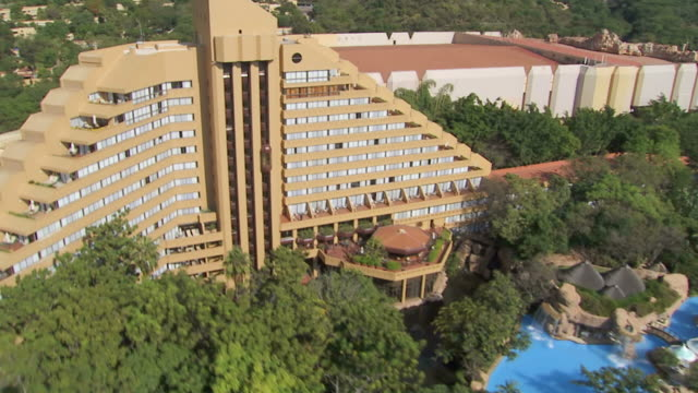 WS AERIAL Shot of trees and hotel building / North West Province, South Africa