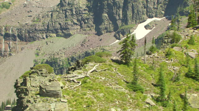 ms aerial zi shot of trees on ridge with sperry chalet in glacier national park / montana, united states - glacier national park us stock videos and b-roll footage
