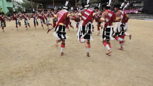 WS TS Shot of tribesmen from Ao tribe dancing at tribal Hornbill Festival AUDIO / Nagaland, India