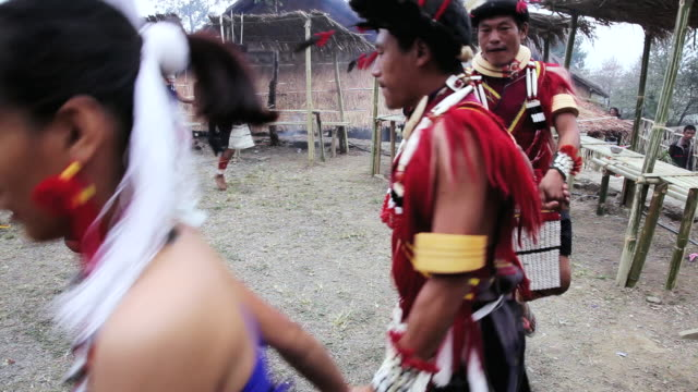 MS PAN Shot of Tribesmen from Ao tribe dancing at tribal Hornbill festival AUDIO / Nagaland, India