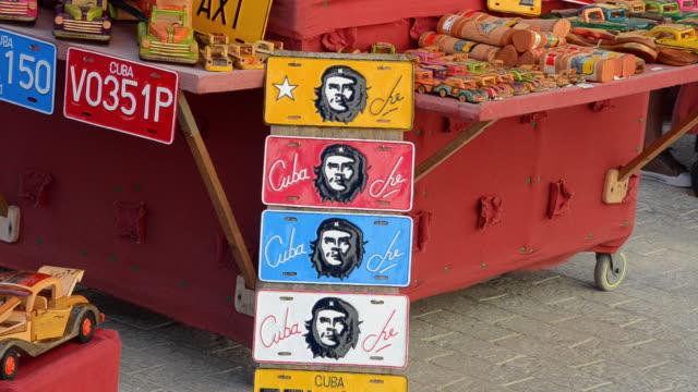 cu shot of trinidad cuba close up of license plates of hero che guevara for sale in market / trinidad, cuba - お土産点の映像素材/bロール