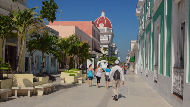 ms shot of trinidad cuba side street with people walking in city downtown in caribbean / trinidad, cuba - sancti spiritus province stock videos and b-roll footage