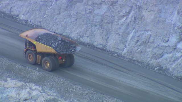 ms ha shot of truck driving up hill / coolgardie and kalgoorlie, western australia, australia - dump truck stock videos and b-roll footage