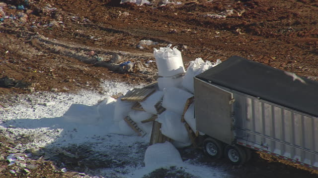 cu aerial shot of truck unloading boxes at landfill (outside fairmont mill) / south carolina, united states - medium group of animals stock videos & royalty-free footage