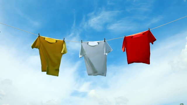 MS Shot of T-shirts hanging on laundry line / Seoul, South Korea