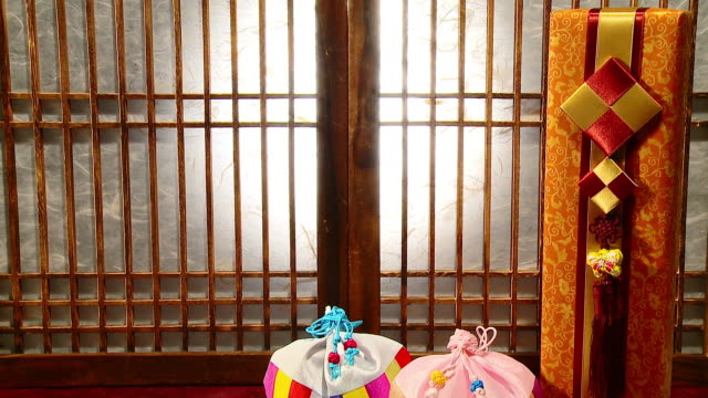 ms td shot of ttoek - korean rice cakes and bokjumeoni (lucky bag) / seoul, south korea - medium group of objects stock videos & royalty-free footage