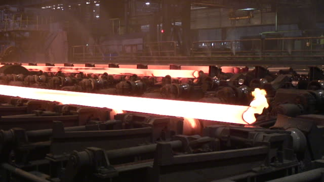 ms shot of tube production at steel mill / mulheim, north rhine westphalia, germany - förderleitung stock-videos und b-roll-filmmaterial