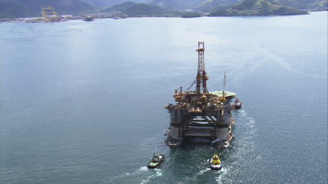ws aerial ts ds zo shot of tug boats near oil rig / rio de janeiro, brazil - oil rig boat stock videos & royalty-free footage
