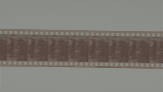 shot of turning developed film rapidly - camera film stock videos & royalty-free footage