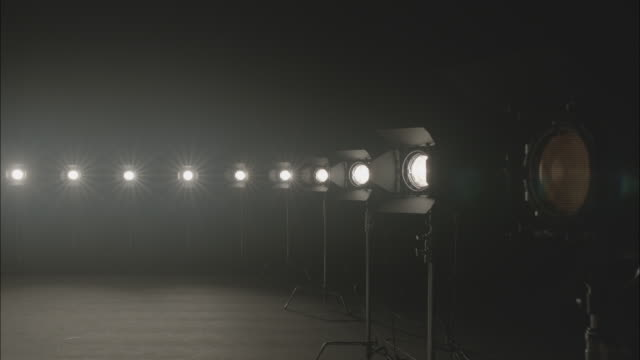 stockvideo's en b-roll-footage met shot of turning on film lighting equipment - middelgrote groep dingen