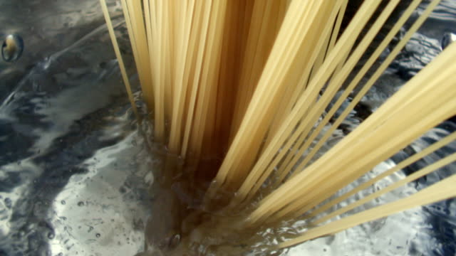 cu slo mo shot of two eggs falling into frying pan / seoul, south korea - pasta video stock e b–roll