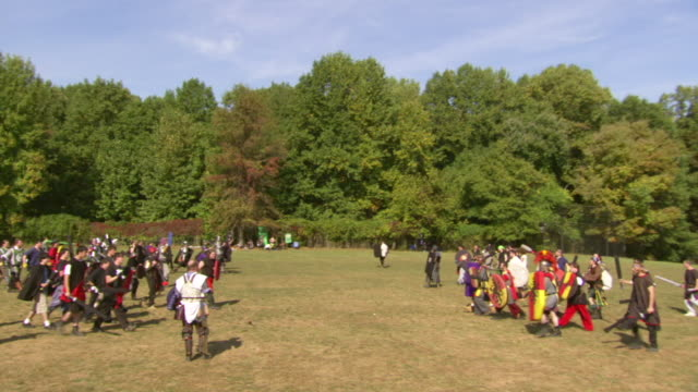 WS ZI Shot of two groups approaching each other and start fighting during Dark on Medieval Fantasy War gaming battle / Derwood, Maryland, United States